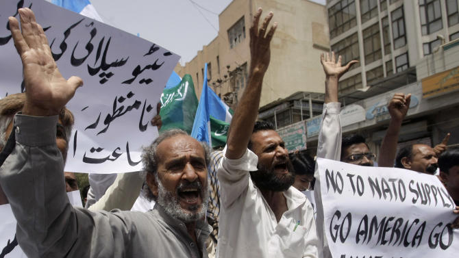 Supporters of a Pakistani religious party Jamaat-e-Islami chant anti-American slogans during a rally against a possible resumption of NATO supplies to neighboring Afghanistan, Friday, May 25, 2012 in Karachi, Pakistan. Pakistan's parliament has unanimously approved new guidelines for the country in its troubled relationship with the United States, a decision that could pave the way for the reopening of supply lines to NATO troops in neighboring Afghanistan. (AP Photo/Fareed Khan)