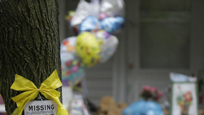 A missing poster still hangs on a tree at the home where Amanda Berry is staying in Cleveland on Saturday, May 11, 2013. Suspect Ariel Castro who allegedly held Berry and two other women captive for nearly a decade is charged with rape and kidnapping. (AP Photo/Tony Dejak)