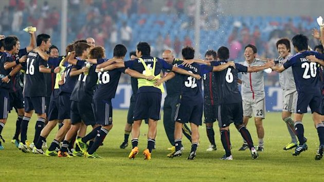 Japan's national team players and coaches celebrate their winning the East Asian Cup championship in Seoul (Reuters)