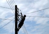 A Sri Lankan workman attempts to reconnect a power supply line in 2004. Sri Lanka announced on Tuesday that electricity would be cut to many homes, shops, offices and government buildings for three hours every day due to shortages from hydro-power stations