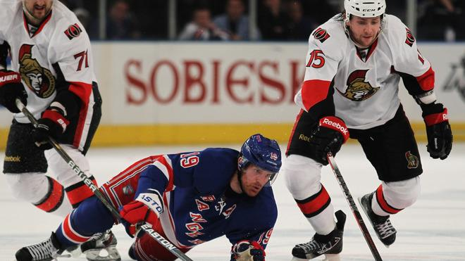 Brad Richards #19 Of The New York Rangers Falls To The Ice As Zack Smith #15 Of The Ottawa Senators Controls The Puck Getty Images