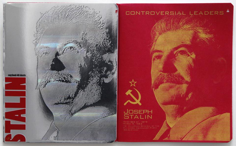 The cover, left, and first page of a notebook bearing a portrait of Soviet dictator Josef Stalin are displayed in Moscow, Wednesday, April 4, 2012. School notebooks with a portrait of Soviet dictator Josef Stalin on the cover have been causing a controversy in Russia since they went on sale this week. (AP Photo/Mikhail Metzel)
