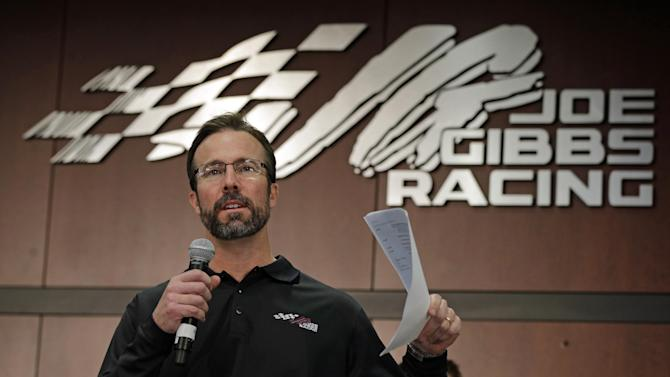 Team president J.D. Gibbs speaks to the media during a news conference at Joe Gibbs Racing in Huntersville, N.C., Thursday, Jan. 24, 2013, as part of the NASCAR Sprint Cup Media Tour. (AP Photo/Chuck Burton)