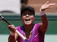 China's Li Na reacts after a point against American Christina McHale during their Women's singles third round match at the French Open. Li won 3-6, 6-2, 6-1 to reach the last 16