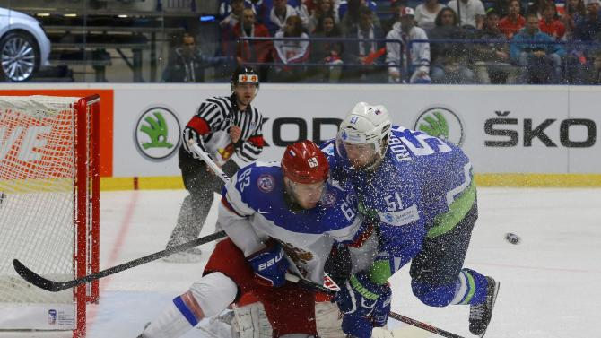 Russia's Dadonov fights for the puck with Slovenia's Robar during their Ice Hockey World Championship game at the CEZ arena in Ostrava