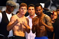 WBC super welterweight champion Saul Alvarez (L) and Shane Mosley pose during the official weigh-in for their bout at the MGM Grand Garden Arena, on May 4, in Las Vegas, Nevada. Alvarez defends his title against Mosley on May 5