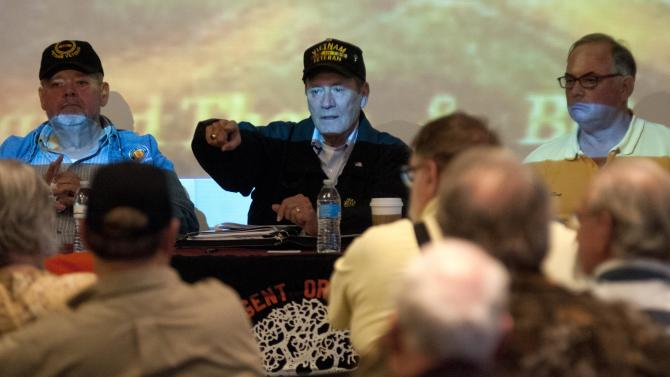 Veterans address questions during a town hall meeting of veterans' advocates and experts on the health effects of Agent Orange in Portland