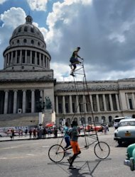 Cuban Felix Guirola rides his giant bicycle on a street in Havana on June 29. For years, he has earned stares of astonishment from fellow Cubans as he pedals his giant bicycle down the streets of Havana