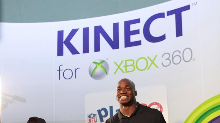 IMAGE DISTRIBUTED FOR XBOX - Young Estevan Rico competes against NFL running back Adrian Peterson at Kinect for Xbox 360 on Thursday, Jan. 31, 2013 in New Orleans. (Photo by Barry Brecheisen/Invision for Xbox/AP Images)