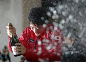 Champagne is sprayed on Japan's Nishikori by his teammates as they celebrate their victory over Canada at their Davis Cup world group first round tennis match in Tokyo