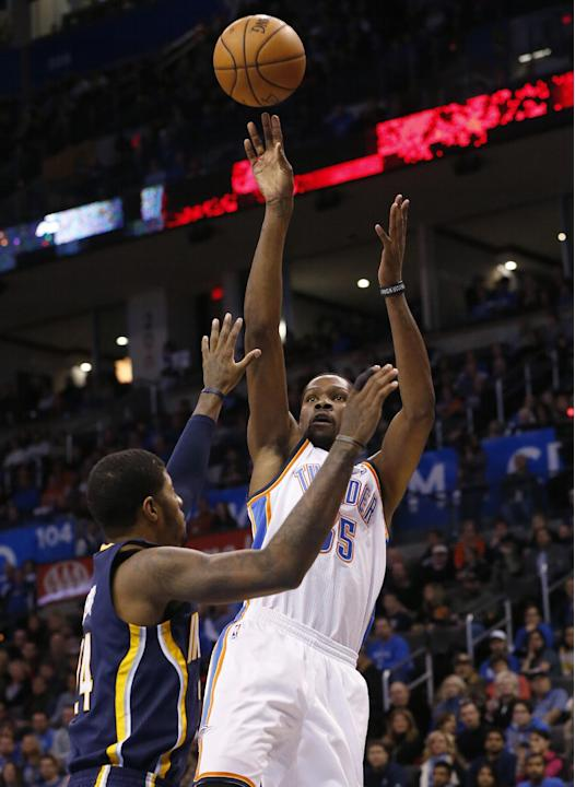 Oklahoma City Thunder forward Kevin Durant (35) shoots over Indiana Pacers forward Paul George (24) in the first quarter of an NBA basketball game in Oklahoma City, Sunday, Dec. 8, 2013