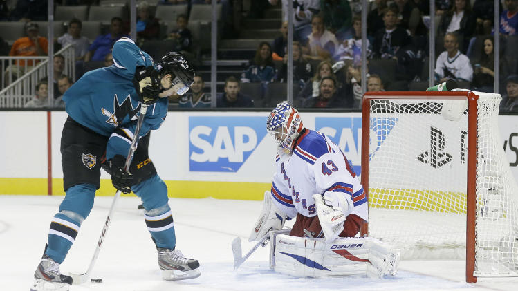 San Jose Sharks' Tomas Hertl, left, of the Czech Republic, scores his fourth goal of the game past New York Rangers goalie Martin Biron (43) during the third period of an NHL hockey game on Tuesday, Oct. 8, 2013, in San Jose, Calif. (AP Photo/Marcio Jose Sanchez)