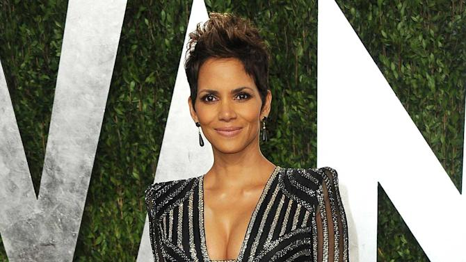 "FILE - This Feb. 24, 2013 file photo shows actress Halle Berry at the 2013 Vanity Fair Oscar party at the Sunset Plaza Hotel in West Hollywood, Calif. The Oscar-winning actress had hoped to move to France with 4-year-old Nahla and Berry's fiance, Oliver Martinez. But a judge in her custody dispute with Nahla's father, Gabriel Aubry, prevented that last year. Berry says she's now trying to figure out how to make life ""more normal"" for Nahla in the Los Angeles area, where they live.  (Photo by Jordan Strauss/Invision/AP, file)"