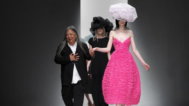 Chinese fashion designer John Rocha at the Spring/Summer 2013 collection during London Fashion Week, Saturday, Sept. 15, 2012. (AP Photo/Jonathan Short)