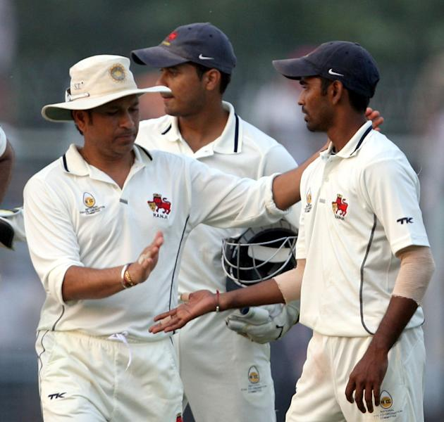 Sachin Tendulkar with team mates during Ranji Trophy match between Haryana and Mumbai played at Bansi Lal Cricket Stadium in Rohtak on Oct.28, 2013. (Photo: IANS)
