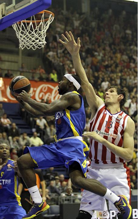 Tyrese Rice of Maccabi Electra Tel Aviv, left, scores past Red Star's Boban Marjanovic during their Round 7, Group D, Euroleague basketball match in Belgrade, Serbia, Thursday, Nov. 28, 2013