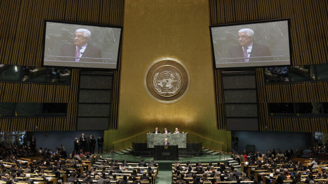 "Palestinian President Mahmoud Abbas acknowledges applause before he addresses the United Nations General Assembly, Thursday, Nov. 29, 2012. In a statement Thursday, Abbas appealed to all nations to vote in favor of the Palestinians ""as an investment in peace.  (AP Photo/Richard Drew)"