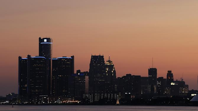 The sun sets on Detroit, Thursday, July 18, 2013. State-appointed emergency manager Kevyn Orr asked a federal judge for permission to place Detroit into Chapter 9 bankruptcy protection Thursday. (AP Photo/Paul Sancya)