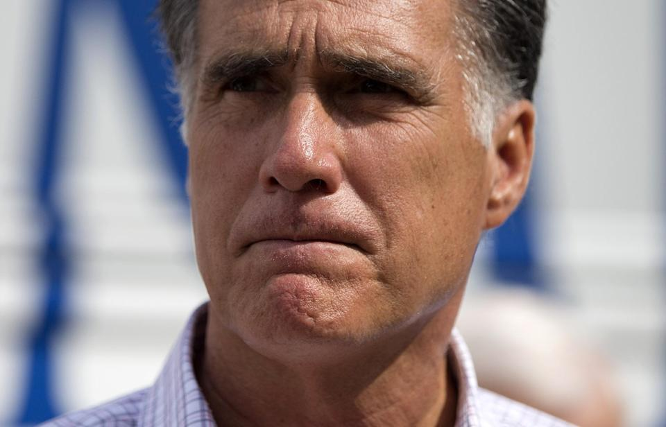 "Republican presidential candidate, former Massachusetts Gov. Mitt Romney speaks with the news media after making a stop at the ""New Hampshire Veterans and Military Families for Mitt"" event, Thursday, Sept. 6, 2012, in Concord, N.H.  (AP Photo/Evan Vucci)"