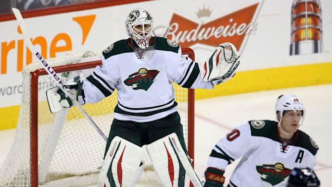 Minnesota Wild's Ilya Bryzgalov (30) taunts the crowd while they chant his name as play continues during third period NHL hockey action against the Winnipeg Jets in Winnipeg, Manitoba, on Monday, April 7, 2014
