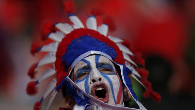 A Chile fan cheers ahead of the start of the the Copa America 2015 final soccer match against Argentina at the National Stadium in Santiago