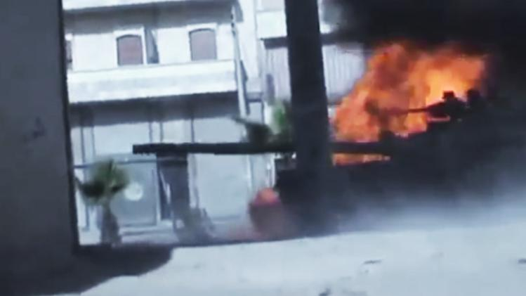 In this image made from amateur video released by the Ugarit News and accessed Monday, July 23, 2012, Syrian government troops are seen on a military tank as it catches on fire during clashes with Free Syrian Army soldiers in Aleppo, Syria. The Syrian regime acknowledged for the first time Monday that it possessed stockpiles of chemical and biological weapons and said it will only use them in case of a foreign attack and never internally against its own citizens. (AP Photo/Ugarit News via AP video) TV OUT, THE ASSOCIATED PRESS CANNOT INDEPENDENTLY VERIFY THE CONTENT, DATE, LOCATION OR AUTHENTICITY OF THIS MATERIAL