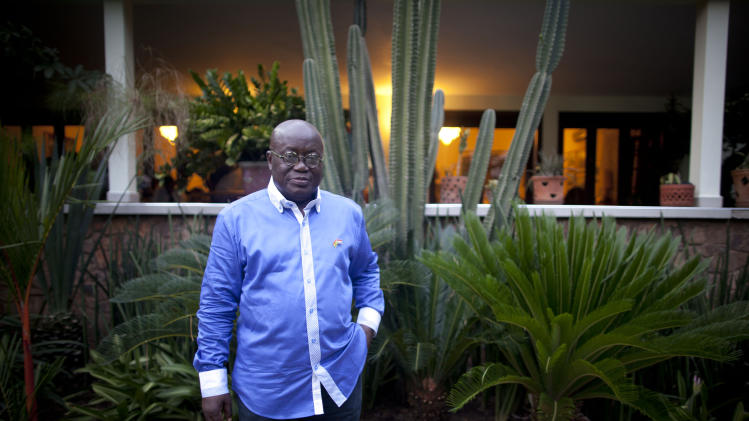 Opposition presidential candidate Nana Akufo-Addo of the New Patriotic Party poses for a portrait in front of his home the evening before presidential elections, in Accra, Ghana, Thursday, Dec. 6, 2012. Ghanaians go to the polls Friday to choose between four candidates including President John Dramani Mahama, who inherited the top post in July after the death of president John Atta Mills, and Akufo-Addo, who lost the presidency by less than 1 percent to Mills in 2008. (AP Photo/Gabriela Barnuevo)