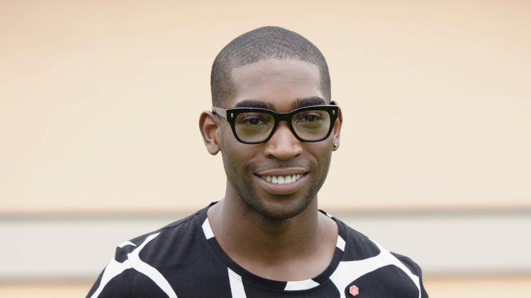 British singer, Tinie Tempah arrives for Burberry Prorsum show,  during London Men's spring summer fashion collections 2014, in London, Tuesday, June 18, 2013. (Photo by Jonathan Short/Invision/AP)