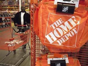 A customer wheels a cart through a Home Depot store in Washington