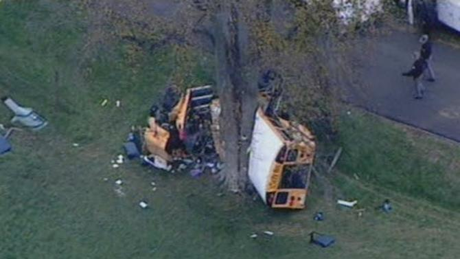 This image taken from video provided by WHAS-TV shows a school bus wreck on Boone Road in Carrollton, Ky. Monday, Oct. 29, 2012. Carroll County Coroner David Wilhoite says there's been a fatality in the wreck in which the bus turned over with children on board. (AP Photo/WHAS-TV)