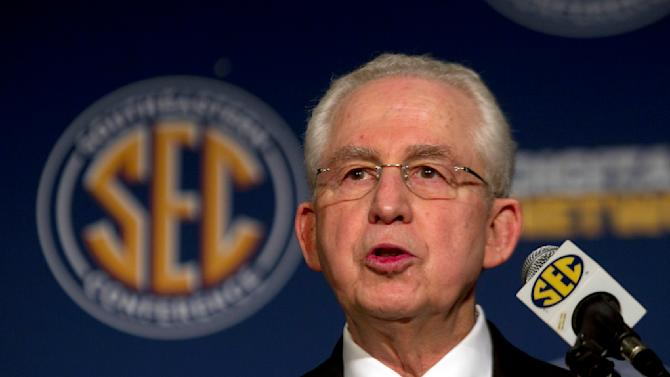Southeastern Conference Commissioner Mike Slive talks with reporters during Southeastern Conference Football Media Days, Wednesday, July 20, 2011, in Birmingham, Ala. (AP Photo/Dave Martin)