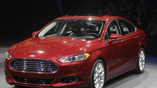 FILE - In this Jan. 9, 2012 file photo, the 2013 Ford Fusion is introduced during the North American International Auto Show in Detroit. Ford hopes the redesigned 2013 Fusion will finally be its Camry killer. The Fusion has become Ford's best-selling car since it went on sale in 2005, and it's one of the top sellers in the country. But Ford hopes the sexier styling, improved fuel economy and cool features like automatic parallel parking on the new Fusion will help it finally trounce the perennial leader, the Toyota Camry. (AP Photo/Carlos Osorio)