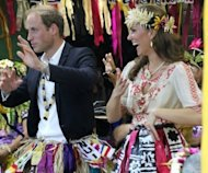 Prince William and Catherine dance during an event in Tuvalu on September 18. The French magazine that published topless photos of the duchess handed over files with the images Wednesday to the couple&#39;s representatives, a source close to the matter said