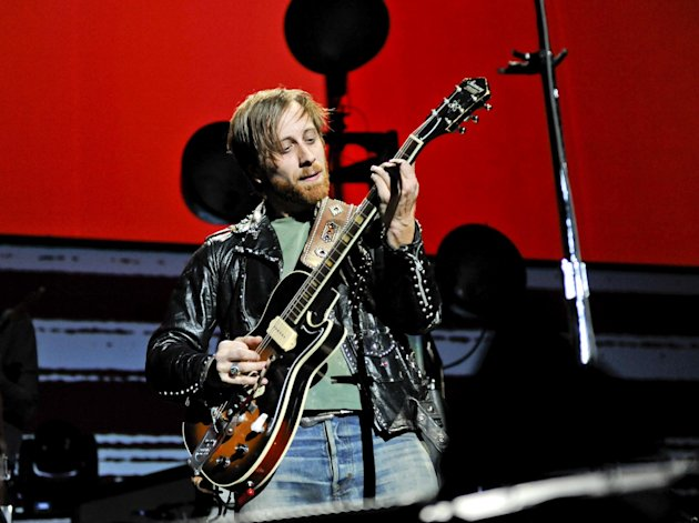 FILE - In this March 12, 2012 file photo, guitarist/vocalist Dan Auerbach of The Black Keys performs at Madison Square Garden, in New York. The Black Keys sued Pizza Hut and Home Depot on June 22, 2012, in Los Angeles, claiming the corporations violated their copyrights by using elements of their songs &quot;Gold on the Ceiling&quot; and &quot;Lonely Boy&quot; in advertisements. (AP Photo/Evan Agostini, File)