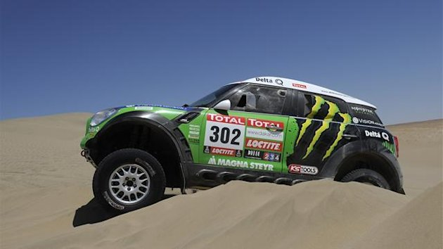 France's driver Stephane Peterhansel steers his Mini during the 2012 Dakar Rally Stage 12 Arequipa-Nasca in Peru, on January 13, 2012.