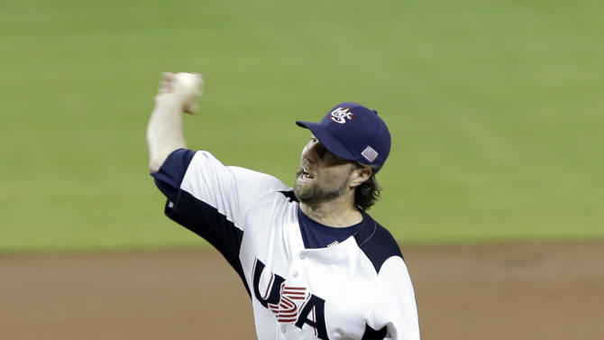 United States' R.A. Dickey pitches against the Dominican Republic during the first inning of a second-round game of the World Baseball Classic in Miami, Thursday, March 14, 2013. (AP Photo/Wilfredo Lee)