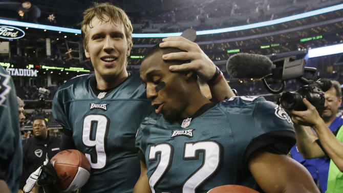 Philadelphia Eagles quarterback Nick Foles (9) and cornerback Brandon Boykin (22) leave the field after an NFL football game against the Dallas Cowboys, Sunday, Dec. 29, 2013, in Arlington, Texas. The Eagles won 24-22
