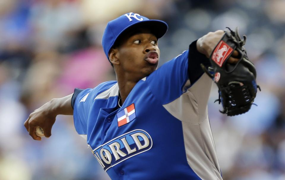 World starting pitcher Yordano Ventura delivers during the first inning of the MLB All-Star Futures baseball game against United States, Sunday, July 8, 2012, in Kansas City, Mo. (AP Photo/Jeff Roberson)