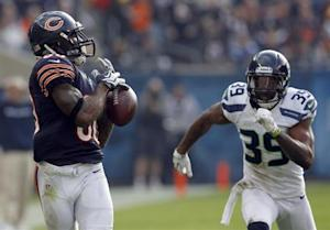 Bears wide receiver Bennett drops a pass as Seahawks cornerback Browner defends during the first half of their NFL football game at Soldier Field in Chicago
