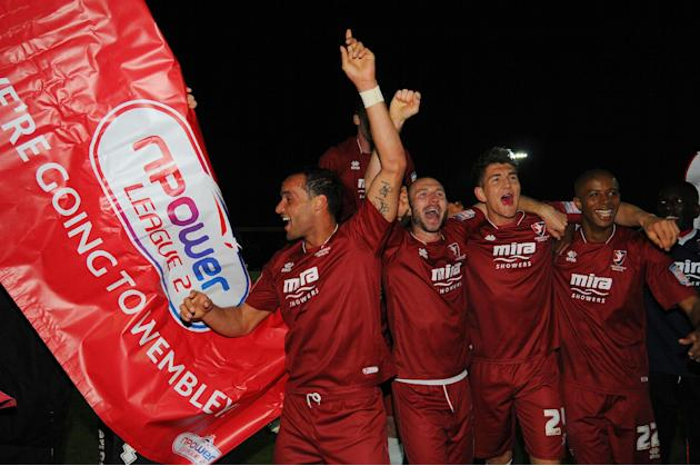 Cheltenham Town players celebrate