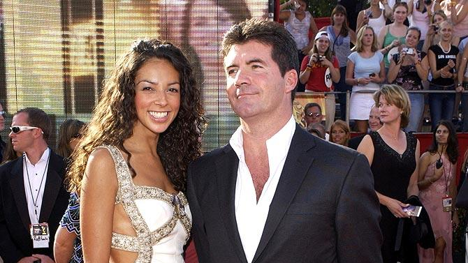 Teri Seymour and Simon Cowell at The 55th Annual Primetime Emmy Awards.