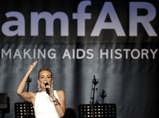 Actresses Stone attends the amfAR's Cinema Against AIDS 2013 event in Antibes during the 66th Cannes Film Festival