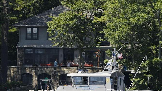 A Police Marine Patrol Boat is seen near the vacation home of Republican presidential candidate Mitt Romney on Lake Winnipesaukee in Wolfeboro, N.H., Sunday, July 1, 2012. (AP Photo/Charles Dharapak)