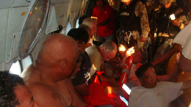 In this image released by the Mexican Navy on Monday July 4, 2011, survivors of a capsized boat sit inside a helicopter after being rescued by the Navy in the town of San Felipe, Mexico Monday July 4, 2011. A U.S. tourist died after a fishing boat capsized in an unexpected storm in the Gulf of California off the Baja California peninsula and of the 44 people on the boat, seven U.S. tourists remain missing along with one Mexican crew member, the Mexican Navy said. (AP Photo/SEMAR)