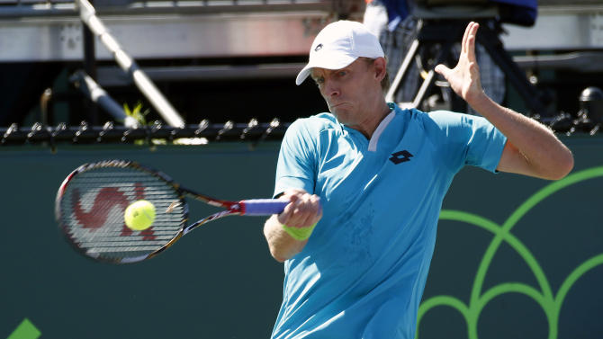 Kevin Anderson, of South Africa, returns the ball to  Leonardo Mayer, of Argentina, during their match at the Miami Open tennis tournament in Key Biscayne, Fla., Sunday, March 29, 2015. (AP Photo/J Pat Carter)