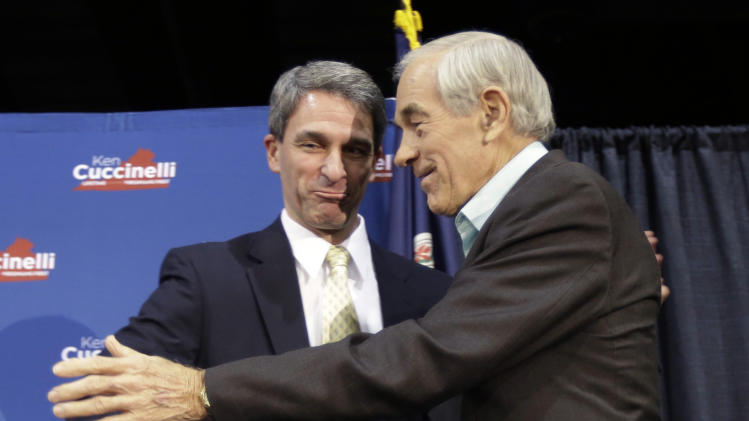 Republican gubernatorial candidate, Virginia Attorney General Ken Cuccinelli, left, greets former U.S. Rep. Ron Paul during a rally in Richmond, Va., Monday, Nov. 4, 2013. Cuccinelli faces Democrat Terry McAuliffe in Tuesday's election. (AP Photo/Steve Helber)