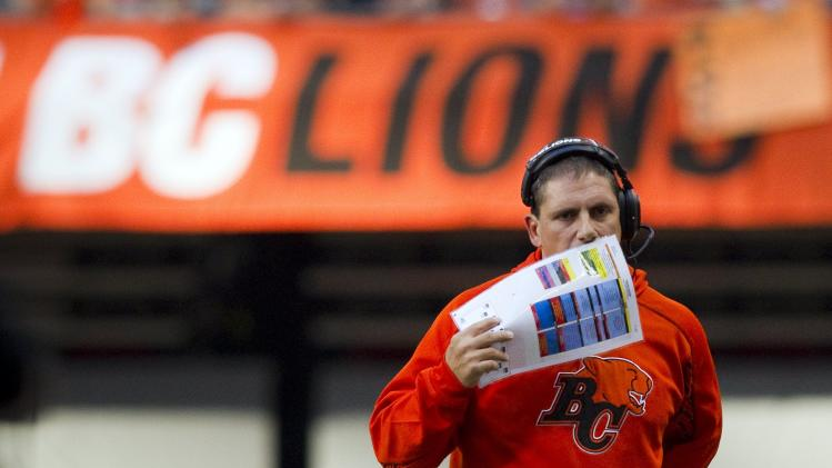 B.C Lions head coach Mike Benevides calls a play while his team plays against Winnipeg Blue Bombers during the first half of their CFL football game in Vancouver.