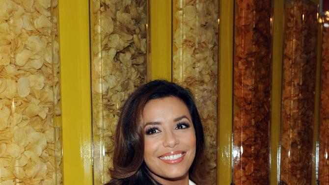 "COMMERCIAL IMAGE - Actress Eva Longoria joins the Lay's brand to kick off the ""Do Us A Flavor"" contest at the Lay's brand's first ever pop-up shop, Friday, July 20, 2012 in New York.  For the first time ever in the US, the Lay's brand is asking consumers to create the next great potato chip flavor. The fan who submits the winning flavor will receive $1 million in grand prize money or one percent of their flavor's 2013 net sales, whichever is higher.  Visit www.facebook.com/lays to enter.  (Photo by Diane Bondareff/Invision for Frito-Lay/AP Images)"