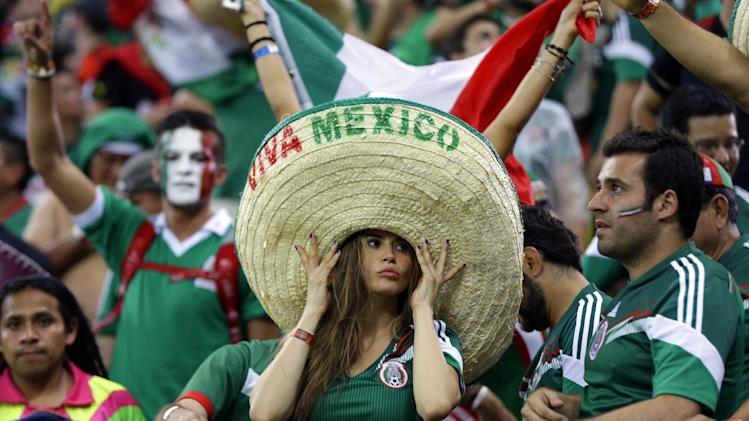 Mexico's fans celebrate after the group A World Cup soccer match between Croatia and Mexico at the Arena Pernambuco in Recife, Brazil, Monday, June 23, 2014. Mexico won 3-1