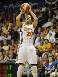Connecticut Sun's Kara Lawson goes up for three points in the first half of a WNBA basketball game against the Indiana Fever in Uncasville, Conn., Wednesday, Sept. 19, 2012.  Lawson was top scorer for Connecticut with 23 points. (AP Photo/Jessica Hill)